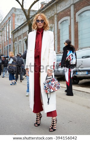 MILAN - FEBRUARY 25: Candela Novembre poses for photographers with white coat and Fendi bag before Fendi fashion show, Milan Fashion Week Day 2 street style on February 25, 2016 in Milan. - stock photo