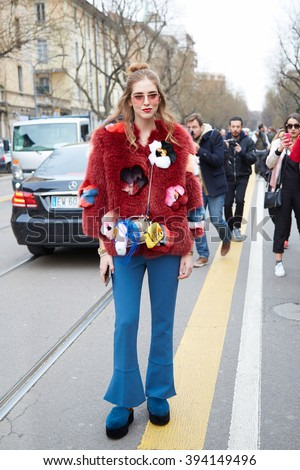 MILAN - FEBRUARY 25: Chiara Ferragni poses for photographers with Fendi bags and red fur before Fendi fashion show, Milan Fashion Week Day 2 street style on February 25, 2016 in Milan. - stock photo