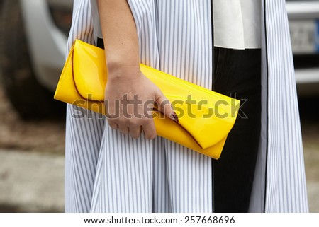 MILAN - FEBRUARY 27: Woman poses for photographers before Emporio Armani show Milan Fashion Week Day 3, Fall/Winter 2015/2016 street style on February 27, 2015 in Milan. - stock photo