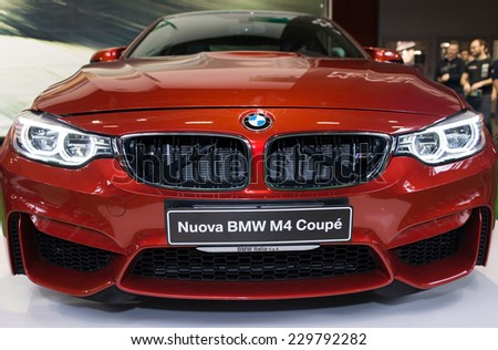 MILAN, IT. NOVEMBER 5, 2014. The new BMW m4 exposed at EICMA 2014. The BMW M4 is a high-performance version of the 4 Series automobile developed by BMW's in-house motorsport division.
