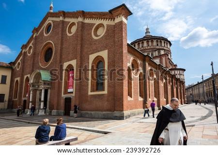Milan, Italy - April 2012: A priest in the square of the Santa Maria delle Grazie church - stock photo