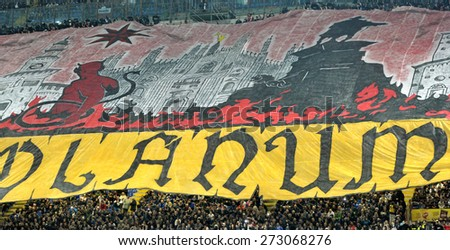 MILAN, ITALY-APRIL 19, 2015: AC Milan soccer fans choreography at the san siro soccer stadium, before the derby match FC Internazionale vs AC Milan,in Milan. - stock photo