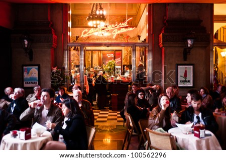 "MILAN, ITALY - APRIL 7: ""Camparino in galleria"" cafe in Milan on April 7, 2012. It is a historical cafe opened in 1915 in Galleria Vittorio Emanuele where it's tradition to drink aperitif with Campari - stock photo"