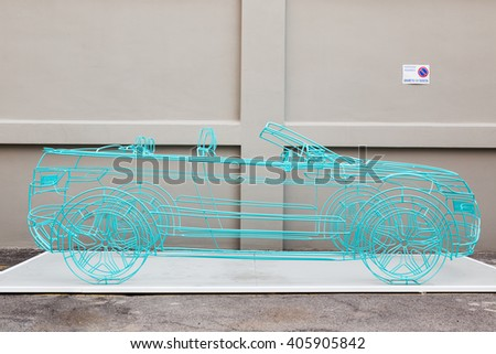 MILAN, ITALY - APRIL 13:Car sculpture on dusplay at Fuorisalone, set of events distributed in different areas of the town during Milan Design Week on APRIL 13, 2016 in Milan. - stock photo