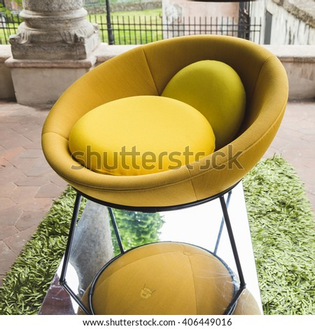MILAN, ITALY - APRIL 15: Chair on display at Fuorisalone, set of events distributed in different areas of the town during Milan Design Week on APRIL 15, 2016 in Milan. - stock photo