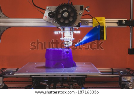 MILAN, ITALY - APRIL 11: 3d printer on display for Fuorisalone at Ventura Lambrate space, location of important events during Milan Design week on APRIL 11, 2014 in Milan - stock photo