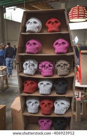 MILAN, ITALY - APRIL 16: Funny cardboard skulls on display at Fuorisalone, set of events distributed in different areas of the town during Milan Design Week on APRIL 16, 2016 in Milan. - stock photo