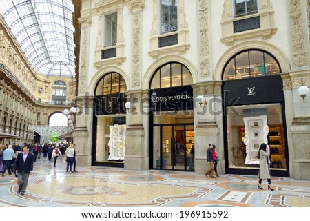 MILAN, ITALY - APRIL 12, 2014: Galleria Vittorio Emanuele's Louis Vuitton store in Milan. The Galleria was designed and built by Giuseppe Mengoni between 1865 and 1877. - stock photo