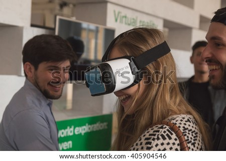 MILAN, ITALY - APRIL 13: Girl wears virtual reality headset at Fuorisalone, set of events distributed in different areas of the town during Milan Design Week on APRIL 13, 2016 in Milan. - stock photo