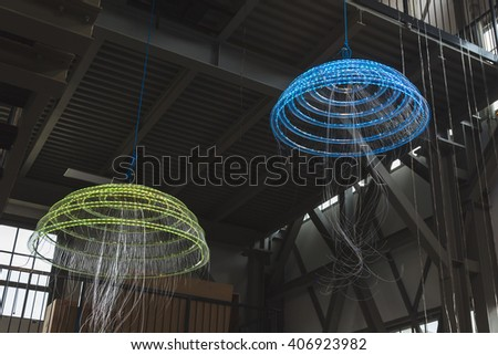 MILAN, ITALY - APRIL 16: Jellyfish installation on display at Fuorisalone, set of events distributed in different areas of the town during Milan Design Week on APRIL 16, 2016 in Milan. - stock photo