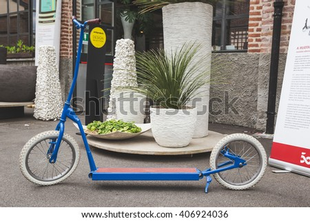 MILAN, ITALY - APRIL 16: Kick scooter on display at Fuorisalone, set of events distributed in different areas of the town during Milan Design Week on APRIL 16, 2016 in Milan. - stock photo