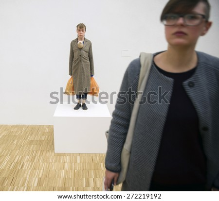 MILAN, ITALY-APRIL 17, 2015: modern art sculpture, woman with shopping bags, exposed during the Arts and Foods exhibition at the architecture, design and arts museum La Triennale, in Milan. - stock photo