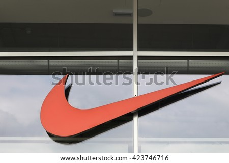 Milan, Italy - April 15, 2016: Nike logo on a face of a store. Nike is an American company specializing in sports equipment based in Beaverton, Oregon, USA