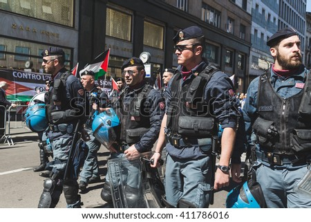 MILAN, ITALY - APRIL 25: Police follow the demonstrators during the Liberation Day parade, end of Mussolini's regime and Nazi occupation in 1945 on APRIL 25, 2016 in Milan. - stock photo