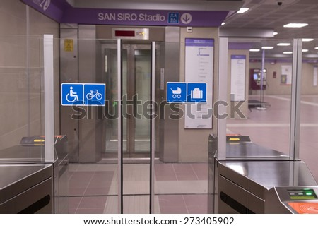 MILAN, ITALY-APRIL 27, 2015: priority automatic entrance door of the new lilac metro station number 5, in Milan. - stock photo