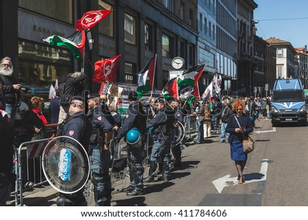 MILAN, ITALY - APRIL 25: Pro-Palestinian demonstrators contest the Jewish Brigade during the Liberation Day parade, end of Mussolini's regime and Nazi occupation in 1945 on APRIL 25, 2016 in Milan. - stock photo