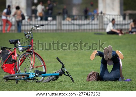MILAN, ITALY - APRIL 12 2015: Since 1889 Milan's Simplon Park (Parco Sempione) has been the favorite destination of generations of locals. It attracts millions of visitors annually. - stock photo