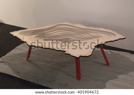 MILAN, ITALY - APRIL 13: Small table on display at Fuorisalone, set of events distributed in different areas of the town during Milan Design Week on APRIL 13, 2016 in Milan. - stock photo