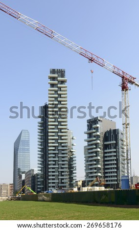 MILAN, ITALY - APRIL 11:  the building site cranes and of tall buildings at business hub prospecting on the wheat field prepared for EXPO 2015 in city center, shot  on april 11 2015  Milan, Italy  - stock photo