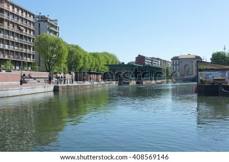 MILAN, ITALY, APRIL 19, 2016: the Darsena, ancient harbour where Naviglio Pavese and Naviglio Grande canals meet, once a node for water-borne transport and trade, now the hub of Navigli district