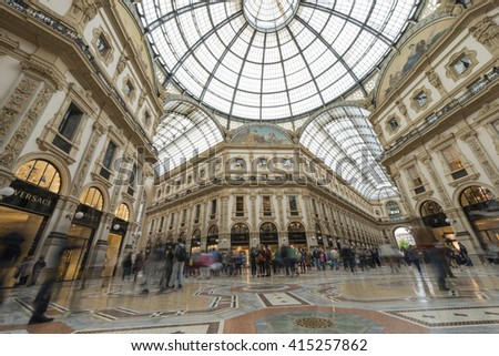 MILAN, ITALY - APRIL 24, 2016: Tourists in Galleria Vittorio Emanuele II. Built in 1875 this gallery is one of the most famous shopping areas in Milan.  - stock photo