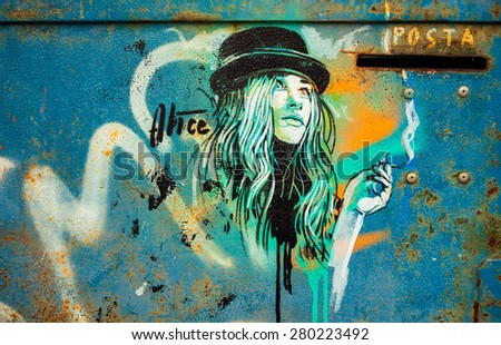 MILAN, ITALY - APRIL 15: View of Girl portrait painted on the wall at Ventura - Lambrate space location during Milan Design Week on APRIL 15 2015 in Milan. - stock photo