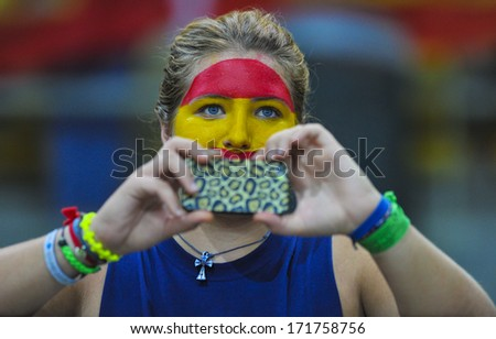 MILAN, ITALY - AUGUST 31: a spanish woman fan taking picture with a smartphone during the American Football European Championship match Italy vs Spain in Milan AUGUST 31, 2013. - stock photo
