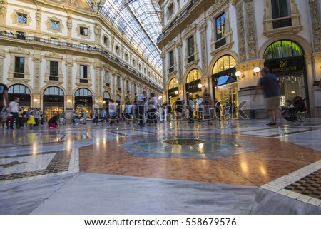 MILAN, ITALY - August 8, 2016: Inside the Galleria Vittorio Emanuele II, one of the world's oldest shopping malls. Housed within a four-story double arcade, it is named after the first king of Italy.