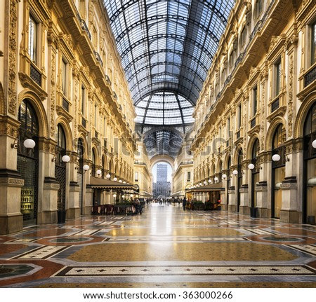 MILAN, ITALY - AUGUST 29, 2015: Luxury Store in Galleria Vittorio Emanuele II shopping mall in Milan, with tasted Italian restaurants - stock photo