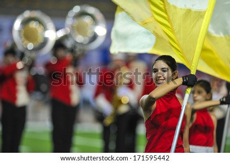 MILAN, ITALY - AUGUST 31: Majorettes and marching band performing before an American Football match between Italy and Spain in Milan August 31, 2013. - stock photo