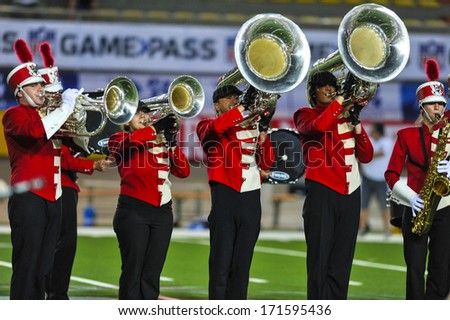 MILAN, ITALY - AUGUST 31: Marching band performing before an American Football match between Italy and Spain in Milan August 31, 2013. - stock photo