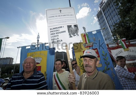 MILAN, ITALY - AUGUST 29: the mayors of small Italian towns protest in Milan August 29, 2011. The government decided to cut the small municipalities to save money.