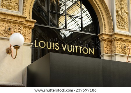 MILAN, ITALY - DEC 23, 2014: Louis Vuitton in Galleria Vittorio Emanuele II, one of the world's oldest shopping malls. The gallery is built between 1865 and 1877 by Giuseppe Mengoni - stock photo