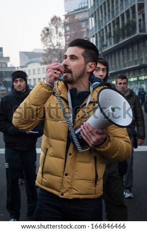 MILAN, ITALY - DECEMBER 10: Demonstrators occupy the city streets blocking the traffic to protest against government and politicians on DECEMBER 10, 2013 in Milan. - stock photo
