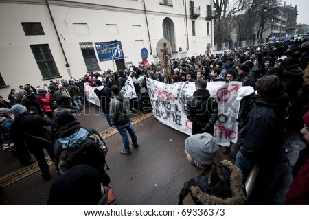 MILAN, ITALY - DECEMBER 22: student demonstration held in Milan December 22, 2010. Students protest against Berlusconi's government and against the new laws on school education minister Gelmini.