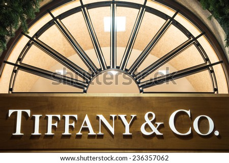 MILAN, ITALY-DECEMBER 02, 2014: Tiffany & Co brand name outside a boutique store in the downtown fashion district, in Milan. - stock photo