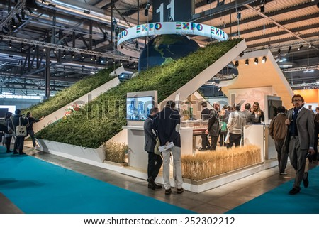 MILAN, ITALY - FEB 12: visitors walk in front of the Expo Milano 2015 world  fair stand during BIT at Rho-Fiera in Milan on February 12, 2015 - stock photo