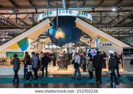 MILAN, ITALY - FEB 12: visitors walk in front of the Expo Milano 2015 World Fair stand during BIT at Rho-Fiera in Milan on February 12, 2015