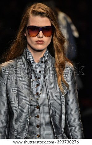 MILAN, ITALY - FEBRUARY 28: A model walks the runway at the Trussardi show during Milan Fashion Week Fall/Winter 2016/17 on February 28, 2016 in Milan, Italy. - stock photo