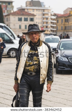 MILAN, ITALY - FEBRUARY 24: Fashionable man wearing hat outside Gucci fashion show building for Milan Women's Fashion Week on FEBRUARY 24, 2016 in Milan.