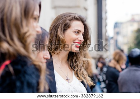 MILAN, ITALY - FEBRUARY 25, 2016: Fashionable woman attending models and vips in the streets during Milan Fashion Week Women Fall/Winter 2016/2017
