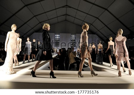 MILAN, ITALY-FEBRUARY 26, 2010: Models on runway catwalk during the spring-summer fashion collection of italian stylist Alberta Ferretti. - stock photo
