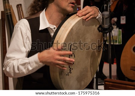 MILAN, ITALY - FEBRUARY 7: Musician playing percussion instrument at Olis Festival, event dedicated to holistic disciplines, alternative medicine and natural food on FEBRUARY 7, 2014 in Milan.