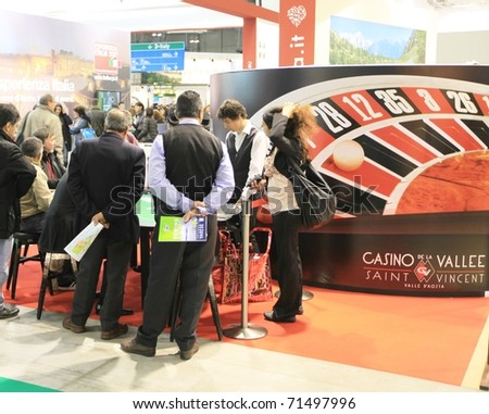 MILAN, ITALY - FEBRUARY 17: People at Casino roulette stand, Valle d'Aosta regional area, Italy pavilion at BIT, International Tourism Exchange Exhibition on February 17, 2011 in Milan, Italy.
