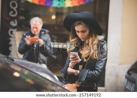 MILAN, ITALY - FEBRUARY 27: People during Milan Fashion week, Italy on February, 27 2015. Eccentric and fashionable people outside city during Milan fashion week wait for models and famous people - stock photo