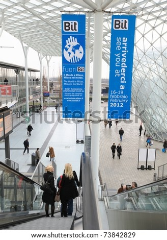 MILAN, ITALY - FEBRUARY 20: People enter World and Italy tourism pavilions during BIT, International Tourism Exchange Exhibition on February 20, 2011 in Milan, Italy. - stock photo