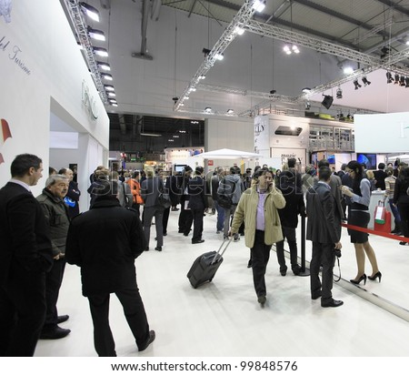 MILAN, ITALY - FEBRUARY 17: People visit Italy national tourism exhibition area at BIT, International Tourism Exchange Exhibition on February 17, 2011 in Milan, Italy. - stock photo