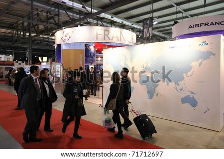 MILAN, ITALY - FEBRUARY 17: People visit the Air France tourism stand at the World pavilion at BIT, International Tourism Exchange Exhibition on February 17, 2011 in Milan, Italy.