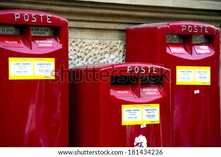 MILAN, ITALY-FEBRUARY 22, 2012: Red mail boxes outside a post office in Milan.