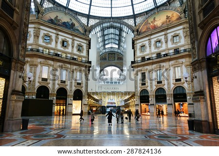 MILAN, ITALY - FEBRUARY 6, 2015: Tourist from Asia in the famous Galleria Vittorio Emanuele II  - stock photo